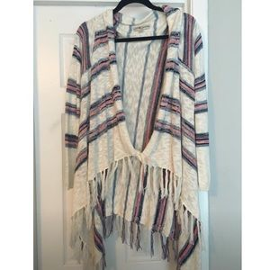 Cream stripped sweater poncho style